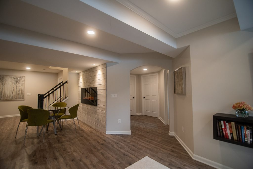 light brown rustic vinyl plank flooring in modern basement
