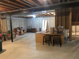 Unfinished basement walls provide a plan