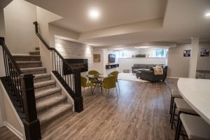 open basement design with fireplace and living room