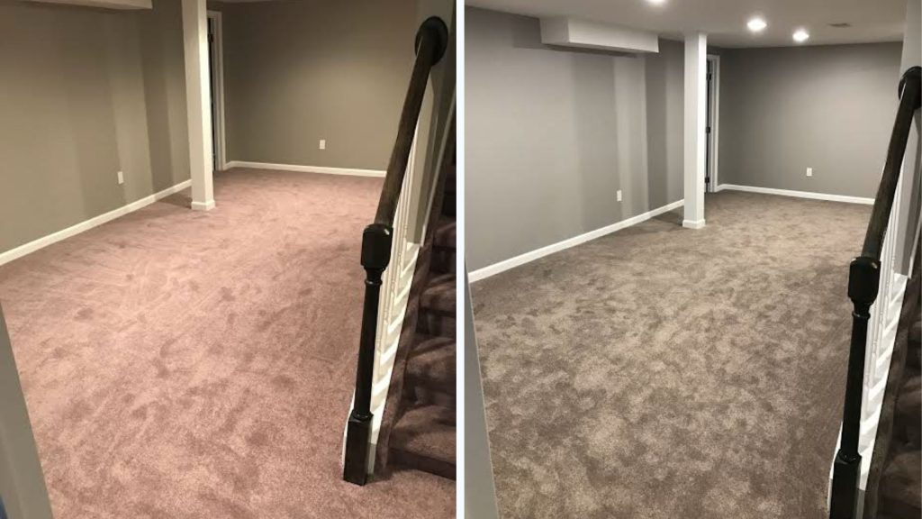 finished basement with carpeting and grey walls with electric fireplace