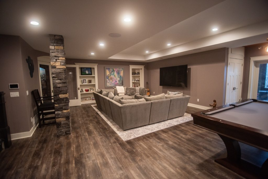 basement living room with detailed ceiling heights