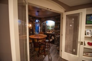wine cellar with french doors in basement