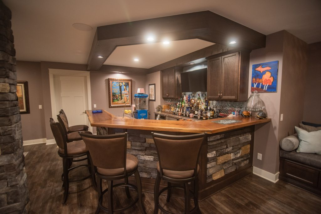 finished bar with wood countertops and wood soffit