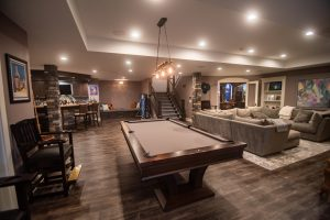 overview of finished basement with warm tones and vinyl plank flooring
