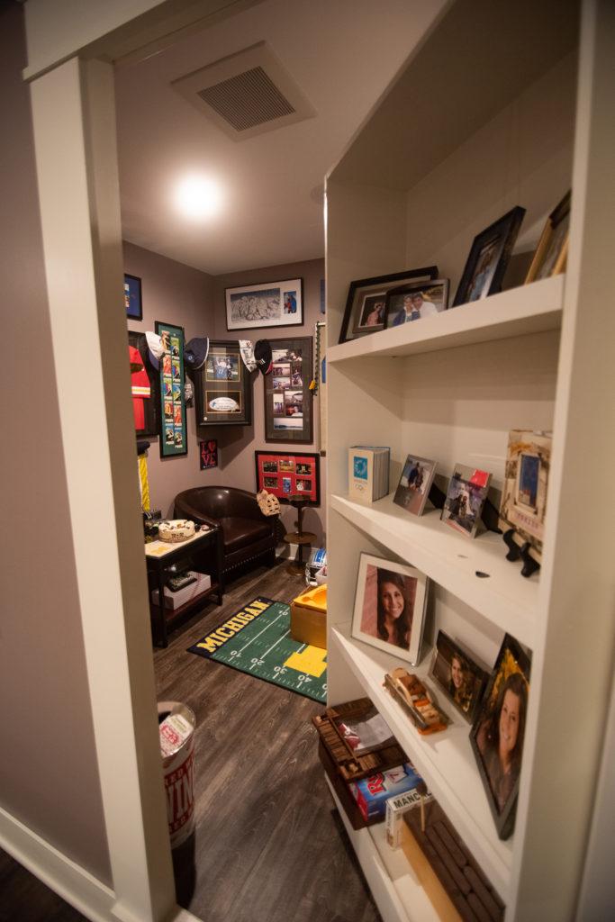 hidden cigar lounge behind secret bookcase door