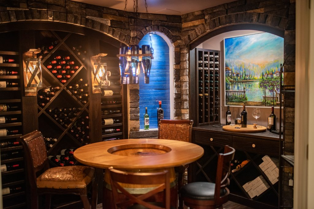 wine cellar with brick accents and wine shelving