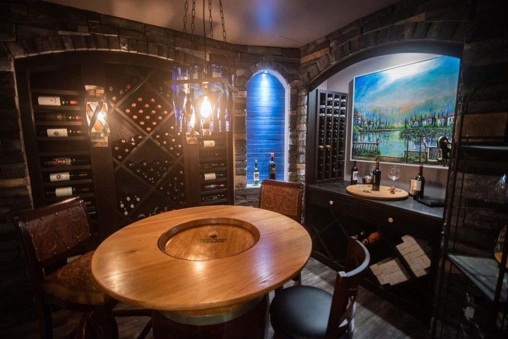 wine cellar with pendant lighting and wine racks