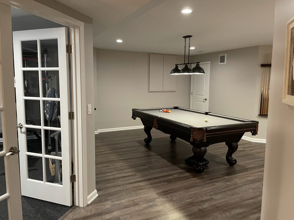 Northville, Michigan finished basement with pool table